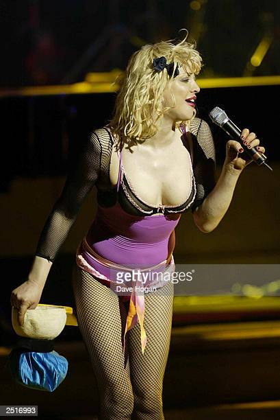 American singer Courtney Love performs on stage at the 'Grand Concert' for the Old Vic Theatre in Old Billingsgate Market on February 5 2003 in London