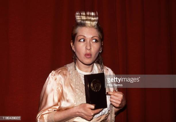 American singer Cyndi Lauper poses with her award for Best Female Rock Vocalist during the New York Music Awards at the Beacon Theatre, New York, New...