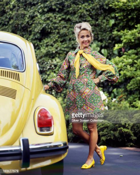 American singer dancer and actress Jane Powell standing next to a Volkswagen Beetle circa 1970