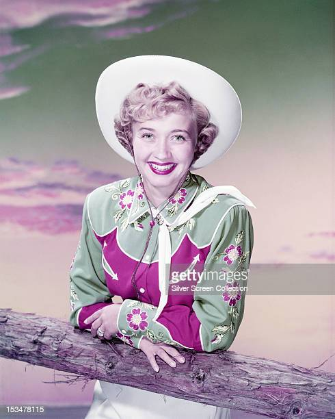 American singer dancer and actress Jane Powell wearing a western shirt and a cowboy hat circa 1955