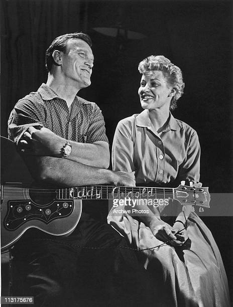 American singer Eddy Arnold performs on a television show with Patti Page circa 1958