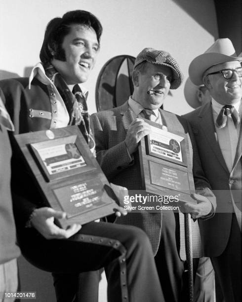 American singer Elvis Presley and his manager Colonel Tom Parker are made life members of the Houston Astrodome Livestock Show and Rodeo in Texas as...