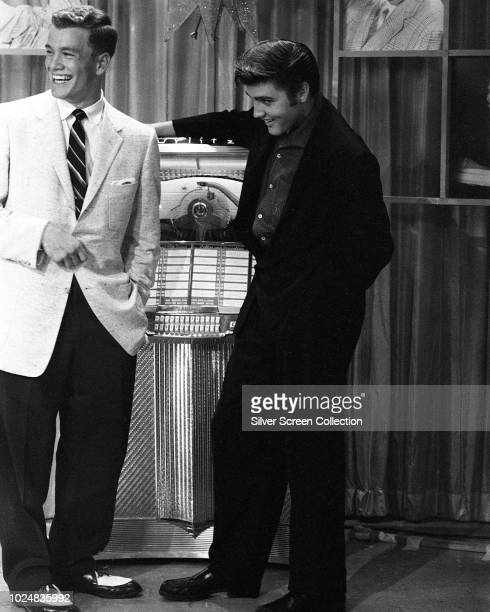 American singer Elvis Presley appears with presenter Wink Martindale on Wink's television show 'Teenage Dance Party' in Memphis Tennessee 16th June...