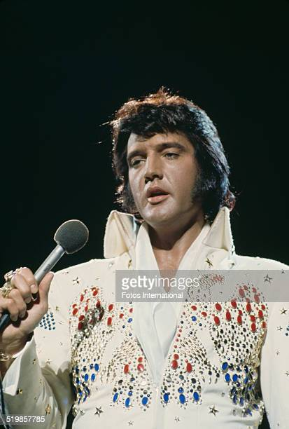 American singer Elvis Presley performing in the 'Aloha from Hawaii Via Satellite', televised concert at the Honolulu International Center, Hawaii,...