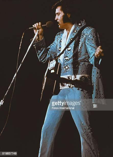 American singer Elvis Presley performing on stage circa 1972