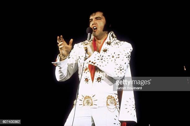 American singer Elvis Presley performing on tour