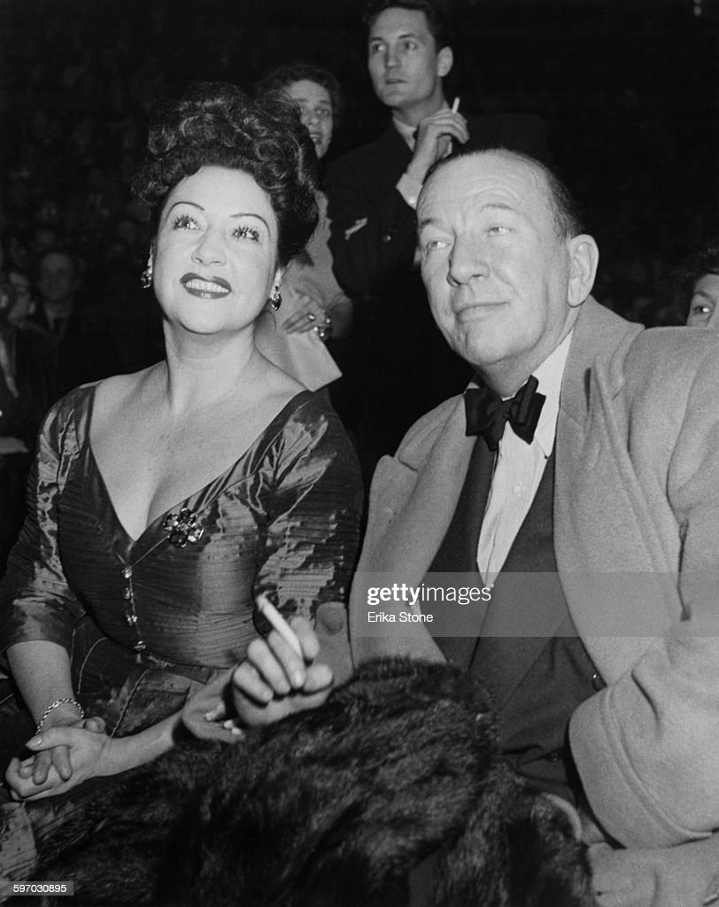 American singer Ethel Merman (1908 - 1984) and English playwright and director Noël Coward (1899 - 1973) attend an election rally in support of Republican candidate Dwight David Eisenhower in Madison Square Garden, New York.