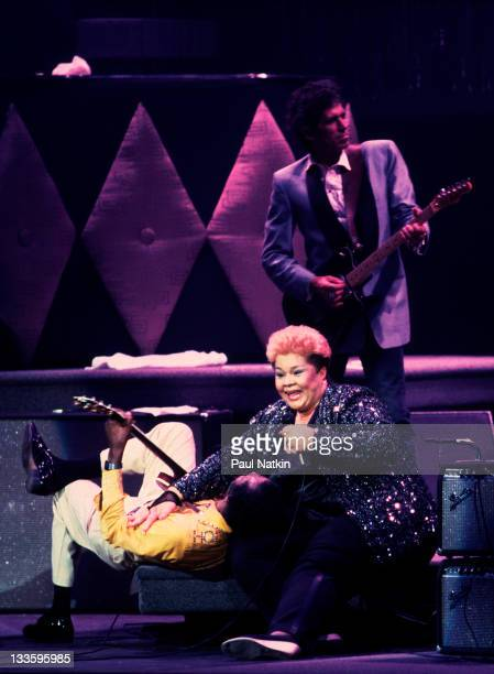 American singer Etta James performs with musician Chuck Berry and British musician Keith Richards on stage at the Fox Theater for a performance...