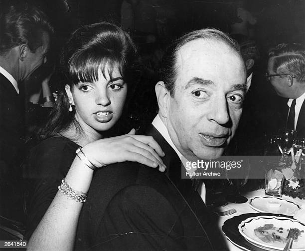 American singer film actress and cabaret performer Liza Minnelli lays a hand of affection on the shoulders of her father film director Vincente...