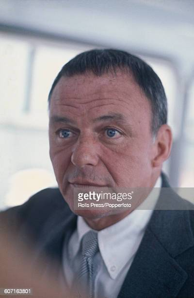 American singer Frank Sinatra pictured at London's Heathrow airport during a stopover after attending the a party hosted by his daughter Tina Sinatra...