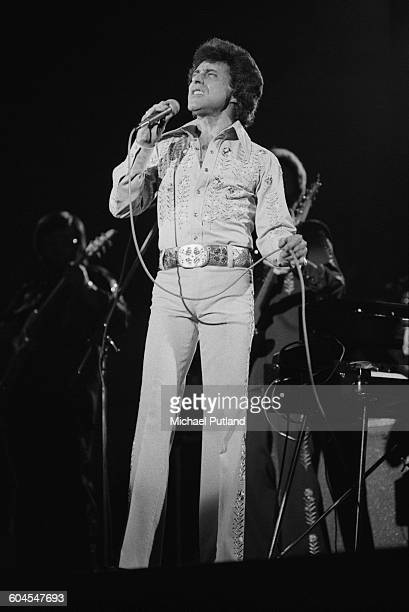 American singer Frankie Valli perfforming with pop vocal group Frankie Valli and the Four Seasons at Fairfield Halls Croydon London 5th April 1976