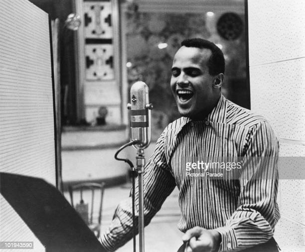 American singer Harry Belafonte performing in a recording studio, circa 1957.