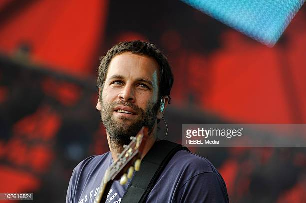American singer Jack Johnson performs on stage on day 4 at the Roskilde Festival on July 4 2010 in Roskilde Denmark