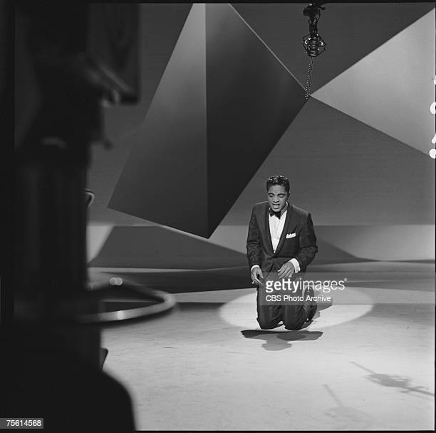 American singer Jackie Wilson on his knee as he performs on an episode of 'The Ed Sullivan Show' New York New York December 4 1960