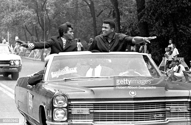 American singer James Brown and boxing champ Muhammad Ali smile and greet parade goers while participating in the annual Bud Billiken parade Chicago...