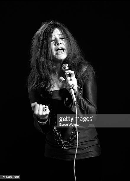 American singer Janis Joplin sings animatedly during a studio shoot for Eye magazine which photographer Baron Wolman called the 'Concert for One' in...