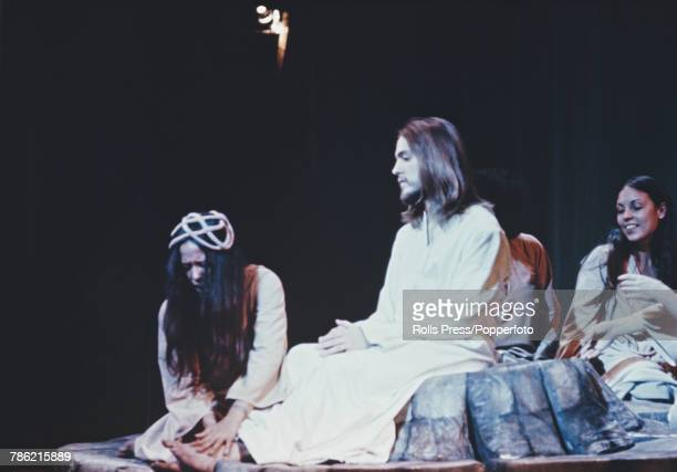 American singer Jeff Fenholt playing the part of Jesus Christ has his feet cleaned by Mary Magdalene played by Yvonne Elliman in a scene from the...