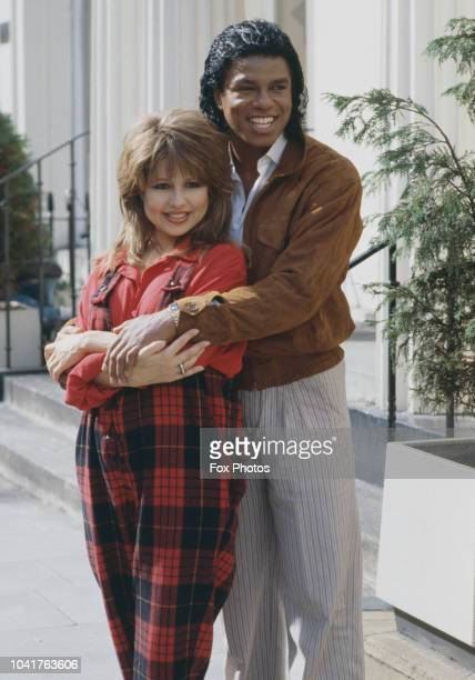 American singer Jermaine Jackson with actress and singer Pia Zadora at the Belfry Club in London to promote their new single 'When the Rain Begins to...