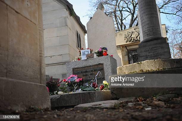American singer Jim Morrison grave stands at Cimetierre du Pere Lachaise on November 29 2011 in Paris France