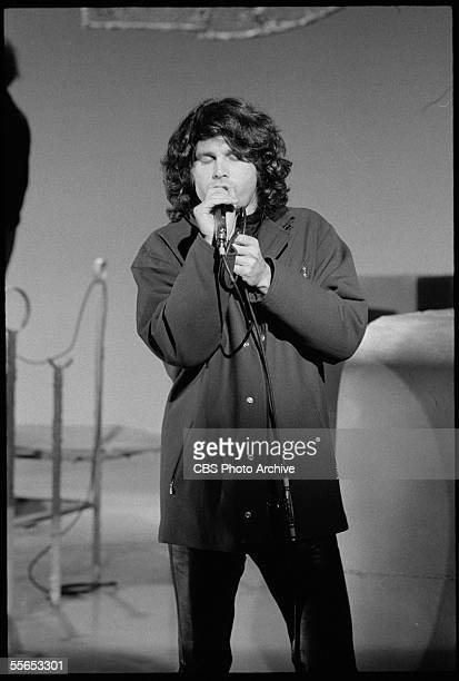 American singer Jim Morrison leader of the rock band The Doors closes his eyes as he performs on 'The Smothers Brothers Comedy Hour' California...