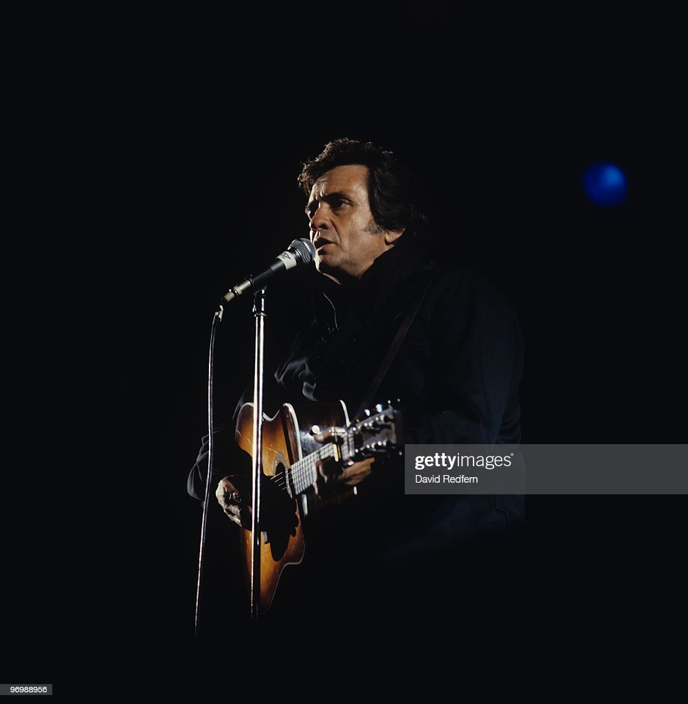 American singer Johnny Cash performs on stage at the Country Music Festival held in Portsmouth, England on August 10, 1980.