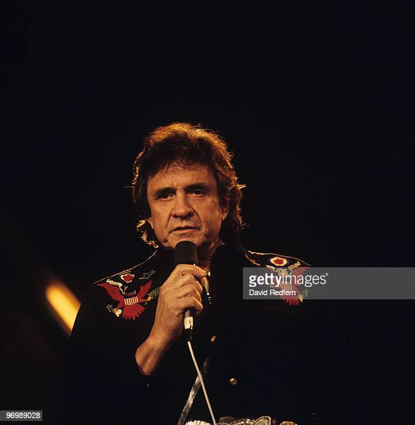 American singer Johnny Cash performs on stage at the Country Music Festival held at Wembley Arena London on March 31 1986