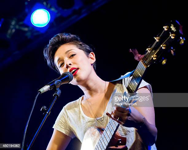 American singer Kina Grannis performs live during a concert at the Frannz on June 6 2014 in Berlin Germany