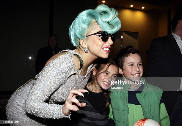American singer Lady Gaga is greeted by scores of fans as she arrives at the Park Hyatt Hotel The Rocks in Sydney New South Wales during her 'Born...
