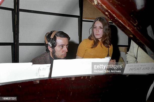 American singer Lani Hall and Sergio Mendes of Sergio Mendes and Brasil '66 record at United Western Recorders studios on March 3 1967 in Los angeles...