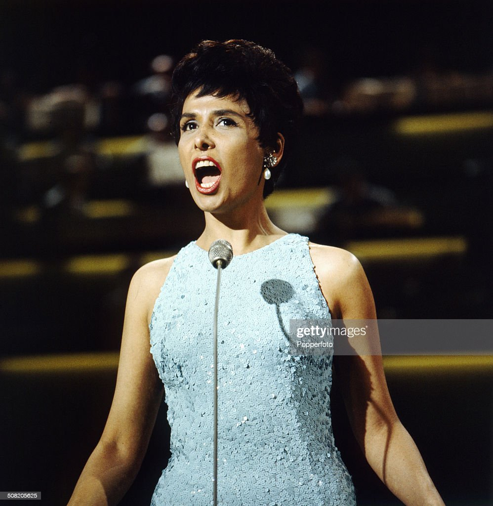 American singer Lena Horne (1917-2010) performs on a television show in 1965.