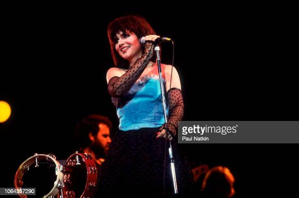 American singer Linda Ronstadt performs on stage at the Marcus Ampitheater in Milwaukee, Wisconsin, July 7, 1983.