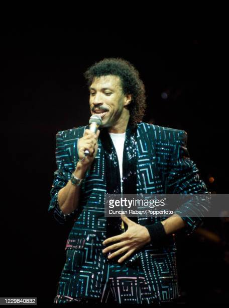 """American singer Lionel Richie performing on stage during """"The Outrageous Tour"""" at the NEC Arena in Birmingham, England on 16 March, 1987."""
