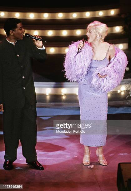 American singer Madonna and American singer and producer Babyface performing at the 45th Sanremo Music Festival. Sanremo, 1995