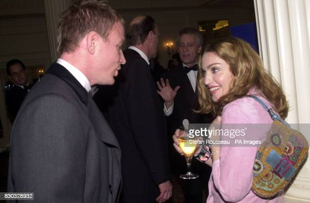American singer Madonna and her boyfriend British film director Guy Ritchie at the Evening Standard British Film Awards held at the Savoy Hotel in...