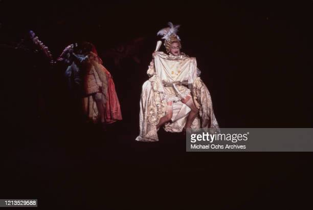 American singer Madonna performs in 18th century French dress at the Wiltern Theatre in Los Angeles California to benefit APLA 7th September 1990 She...