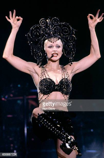 """American singer Madonna performs on stage during her """"Girlie Show"""" world tour on September 25, 1993 at Wembley Stadium in London, England."""