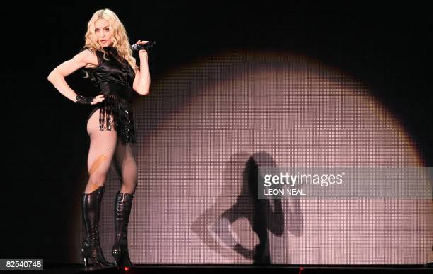 """American singer Madonna performs onstage at the Cardiff Millennium Stadium on August 23, 2008 during the first concert of her """"Sticky and Sweet""""..."""