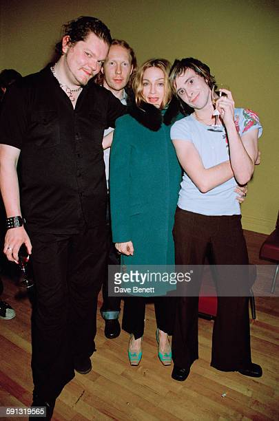 American singer Madonna poses with British trip hop band the Sneaker Pimps during one of their concerts at the ICA in London UK 4th November 1999 Joe...