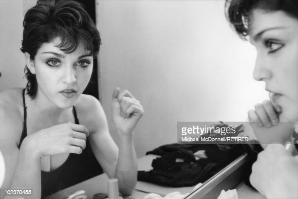American singer Madonna reflected in a dressing room mirror, New York City, Spring 1979. She has recently moved to New York City to study dance.