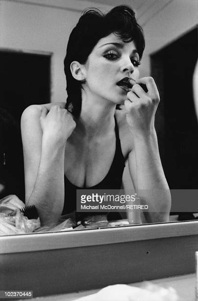 American singer Madonna reflected in a mirror as she applies lipstick New York City Spring 1979 She has recently moved to New York City to study dance