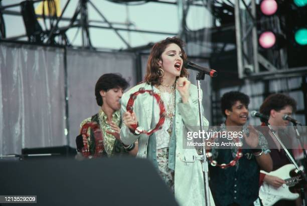 American singer Madonna takes part in the Live Aid benefit concert at the John F Kennedy Stadium in Philadelphia, USA, 13th July 1985.