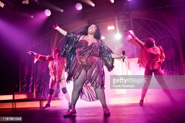 American singer Melissa Viviane Jefferson aka Lizzo performs live on stage during a concert at the Columbiahalle on November 14, 2019 in Berlin,...