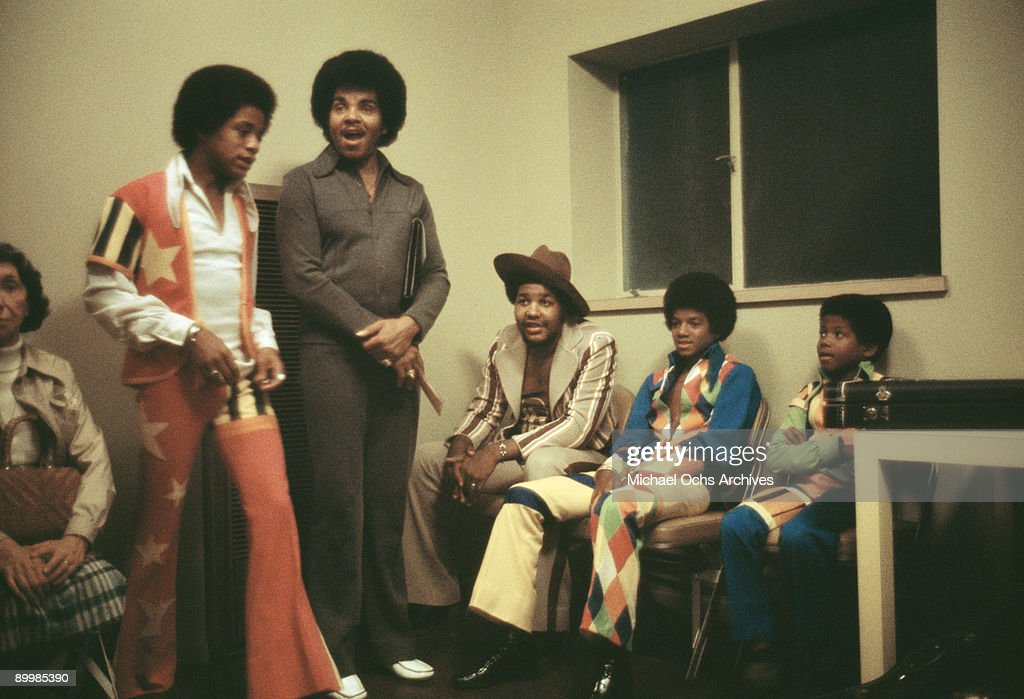 American singer Michael Jackson (1958 - 2009) and his brothers Randy and Marlon backstage at the Inglewood Forum with their father and manager, Joseph Jackson, 26th August 1973.