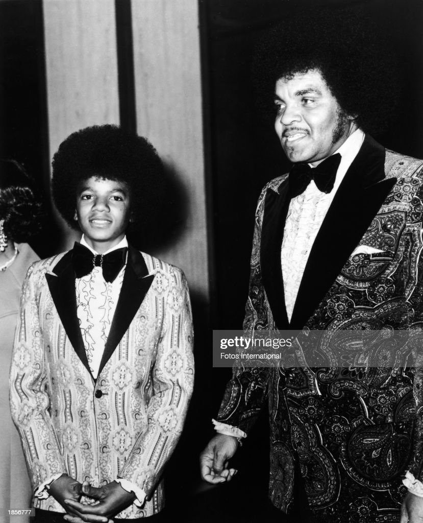 American singer Michael Jackson and his father Joe Jackson pose at the Golden Globe Awards, 1973.