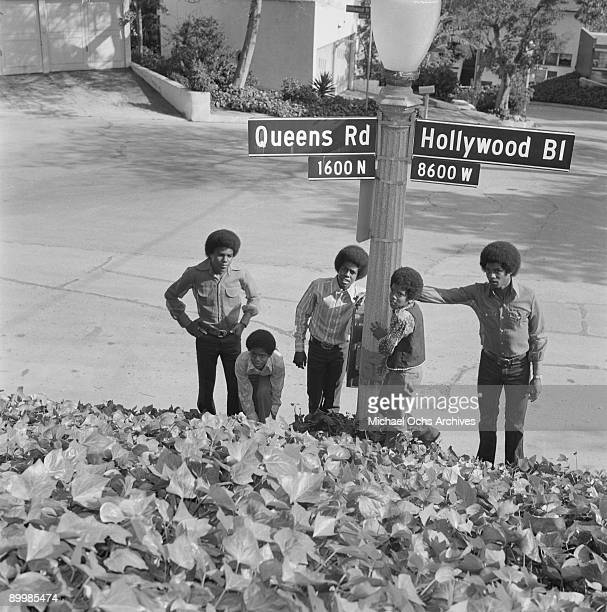 American singer Michael Jackson and the Jackson Five pose by the sign for Queens Road and Hollywood Boulevard in Los Angeles circa 1971 From left to...