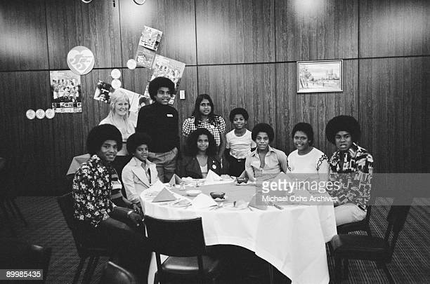 American singer Michael Jackson and the Jackson Five pose with fans during a tour of Australia 1st July 1973