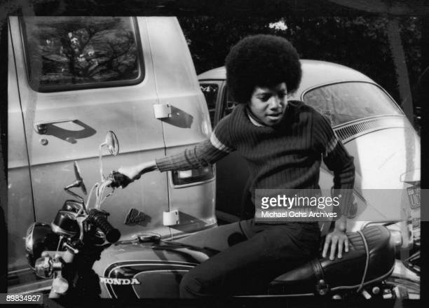American singer Michael Jackson at home on a Honda motorcycle Los Angeles 18th December 1972 A photoshoot for 'Right On' magazine