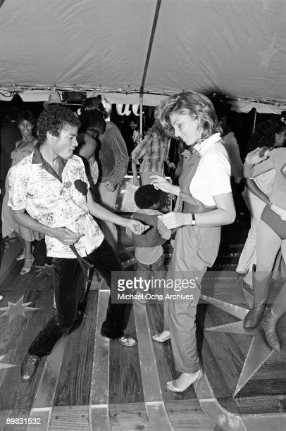 American singer Michael Jackson dances with actress Tatum O'Neal at a party to celebrate the Jacksons' gold records 21st June 1979