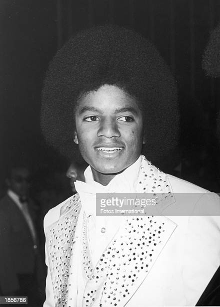 American singer Michael Jackson poses at the Grammy Awards wearing a white tuxedo with sequined lapels at the Hollywood Palladium Hollywood...