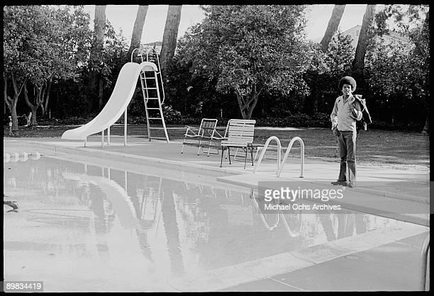 American singer Michael Jackson poses by the swimming pool at his home Los Angeles 20th April 1972 A photoshoot for 'Right On' magazine